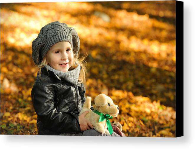 Adorable Canvas Print featuring the photograph Little Girl In Autumn Leaves by Waldek Dabrowski