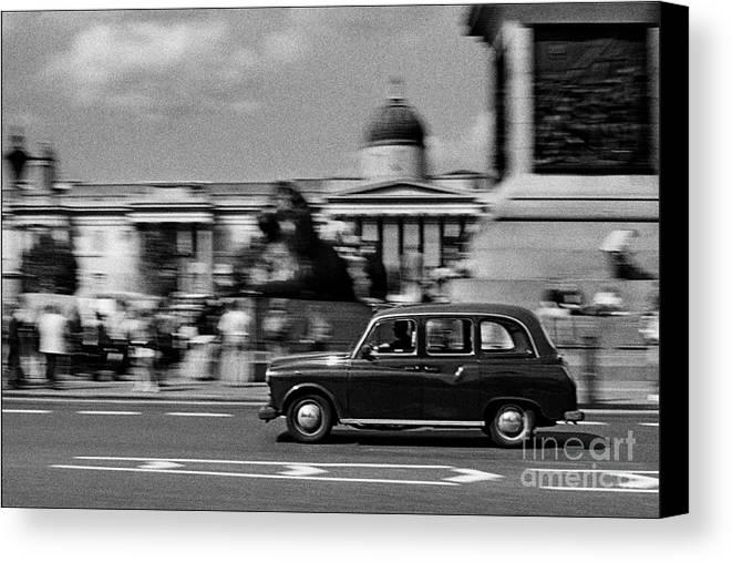 Black Cab Canvas Print featuring the photograph London Cab In Trafalgar Square by Aldo Cervato