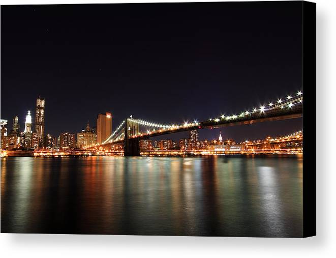 New York City Canvas Print featuring the photograph Manhattan Nightscape With Brooklyn Bridge by Kean Poh Chua