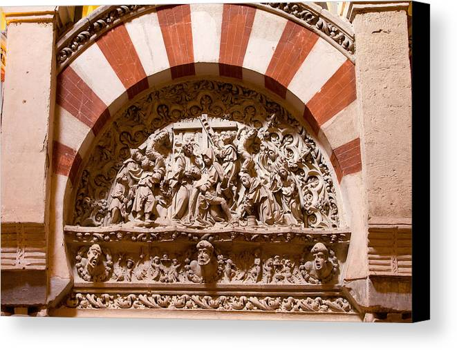 Mezquita Canvas Print featuring the photograph Mezquita Cathedral Religious Carving by Artur Bogacki