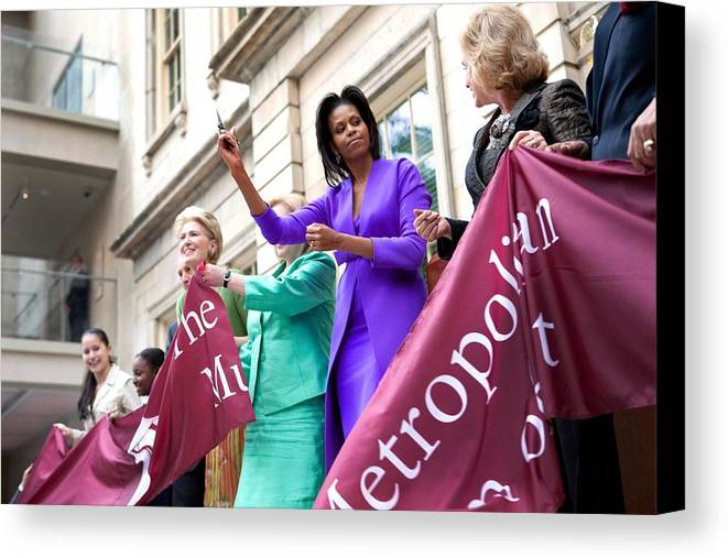 History Canvas Print featuring the photograph Michelle Obama Cuts The Ribbon by Everett