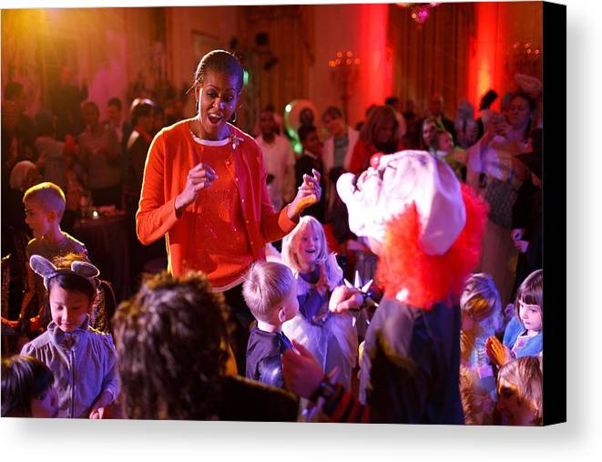 History Canvas Print featuring the photograph Michelle Obama Dancing With Children by Everett