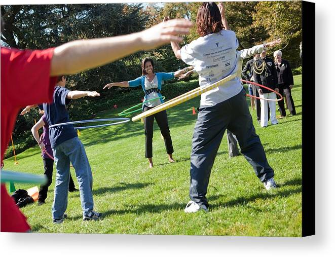 History Canvas Print featuring the photograph Michelle Obama Hula Hoops With Children by Everett