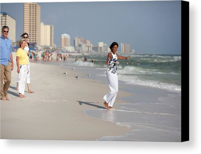 History Canvas Print featuring the photograph Michelle Obama Walks Barefoot by Everett
