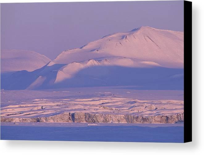 Spitsbergen Canvas Print featuring the photograph Midnight Sunlight On Polar Mountains by Gordon Wiltsie