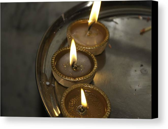 Celebrating Canvas Print featuring the photograph Oil Lamps Kept In A Plate As Part Of Diwali Celebrations by Ashish Agarwal