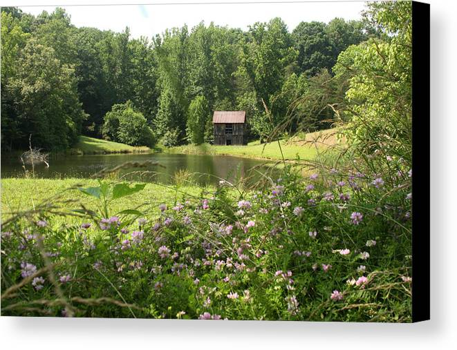 Abandoned Canvas Print featuring the photograph Old Barn Near Pond by Emanuel Tanjala