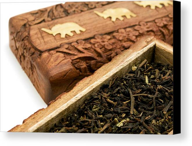 White Background Canvas Print featuring the photograph Ornate Box With Darjeeling Tea by Fabrizio Troiani