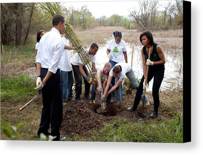 History Canvas Print featuring the photograph President And Michelle Obama Help Plant by Everett