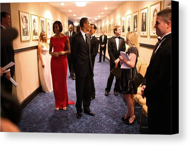 History Canvas Print featuring the photograph President Obama And Michelle Obama Wait by Everett