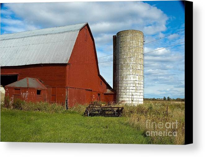 Barn Canvas Print featuring the photograph Red Barn With Silo by Ginger Harris