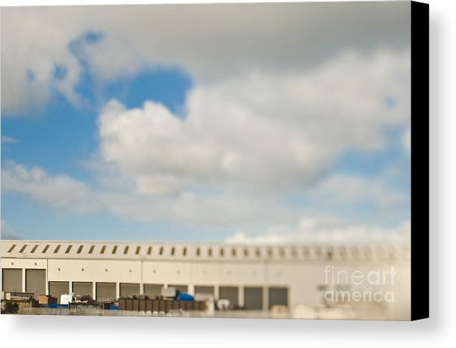 Architecture Canvas Print featuring the photograph Rolling Doors Of A Warehouse by Eddy Joaquim