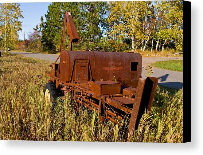 Junk Canvas Print featuring the photograph Rusty by Wayne Stabnaw