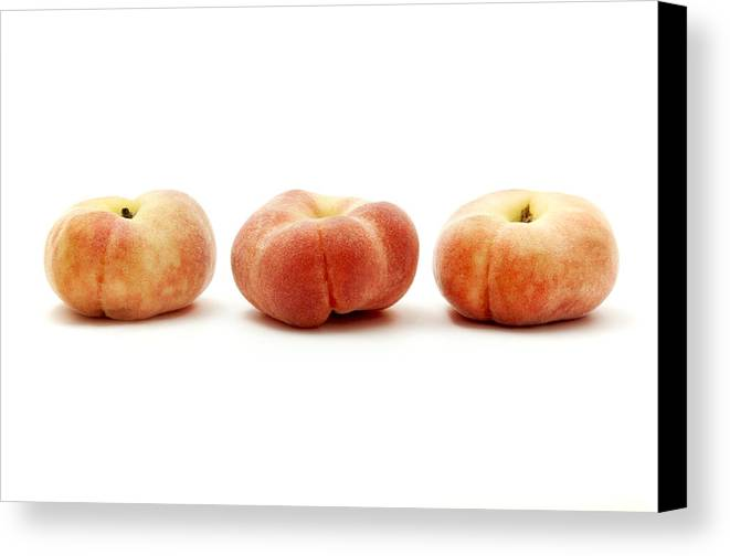 White Background Canvas Print featuring the photograph Saturn Peaches by Fabrizio Troiani