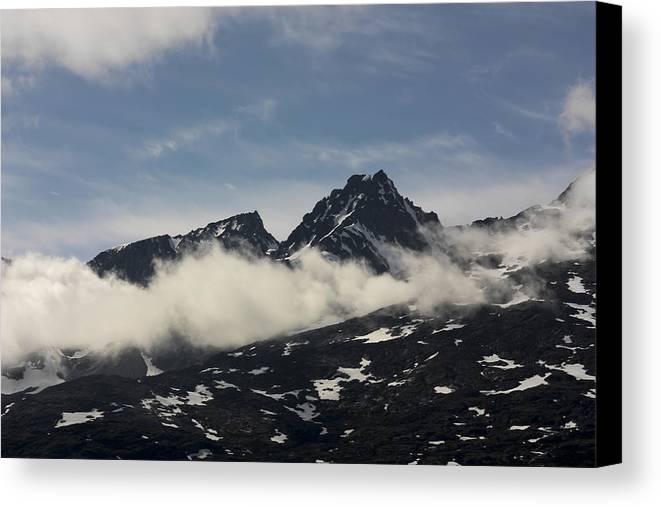 Alaska Canvas Print featuring the photograph Scaling The Peeks by Jason Macko