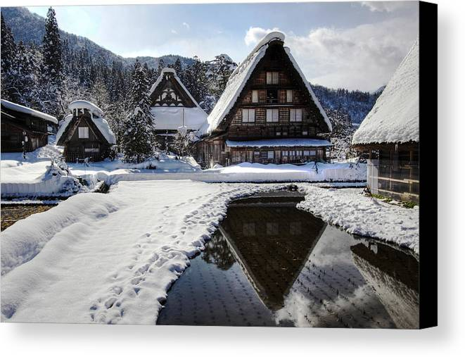 Snow Canvas Print featuring the photograph Snowy Village by Kean Poh Chua