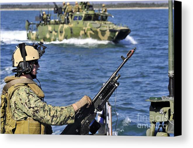 Exercise Bold Alligator Canvas Print featuring the photograph Soldier Mans A M240g Machine Gun While by Stocktrek Images