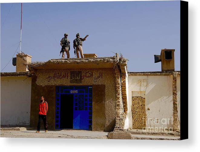 Atop Canvas Print featuring the photograph Soldiers Discuss The New Iraqi Police by Stocktrek Images