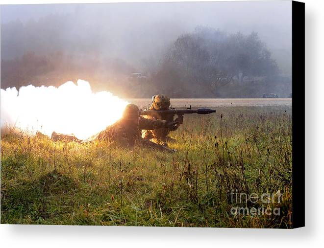 Shooting Canvas Print featuring the photograph Soldiers Fire A Rocket Propelled by Stocktrek Images