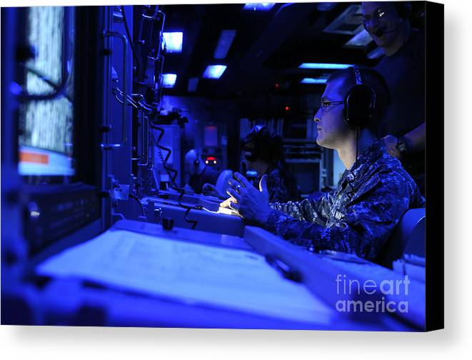 Warship Canvas Print featuring the photograph Sonar Technician Stands Watch by Stocktrek Images