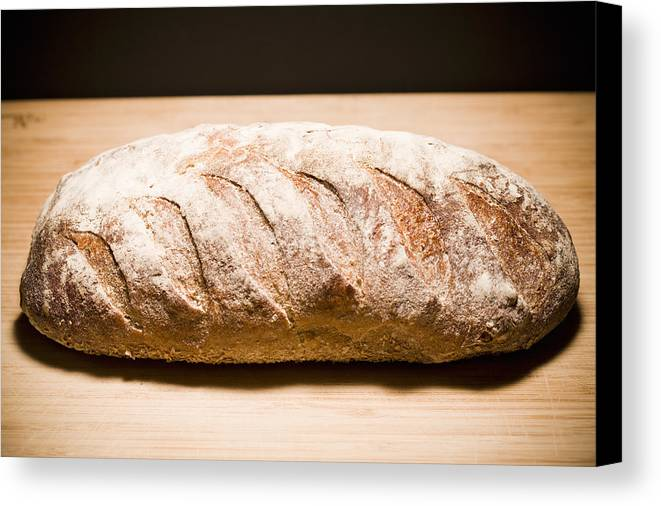 Horizontal Canvas Print featuring the photograph Studio Shot Of Loaf Of Bread by Kristin Lee