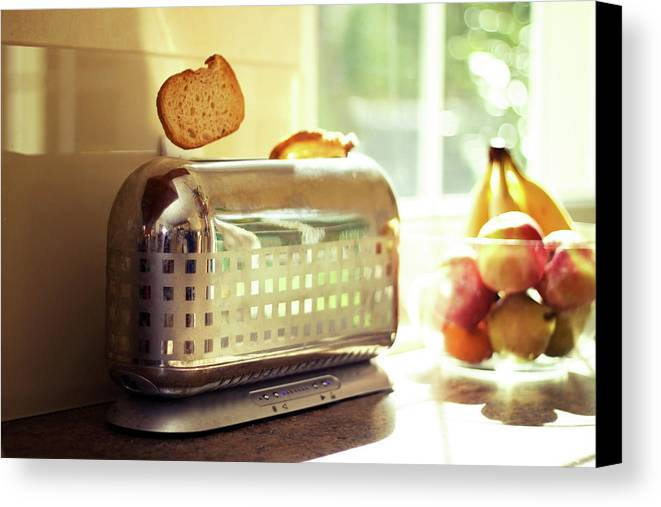 Horizontal Canvas Print featuring the photograph Stylish Chrome Toaster Popping Up Toast by Kelly Sillaste