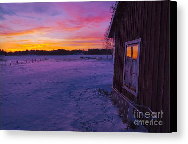Canvas Print featuring the photograph Sun Setting Over Winter Landscape And A Small House by Kathleen Smith