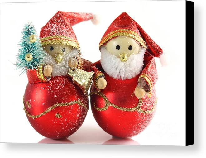 Background Canvas Print featuring the photograph Two Father Christmas Decorations by Simon Bratt Photography LRPS