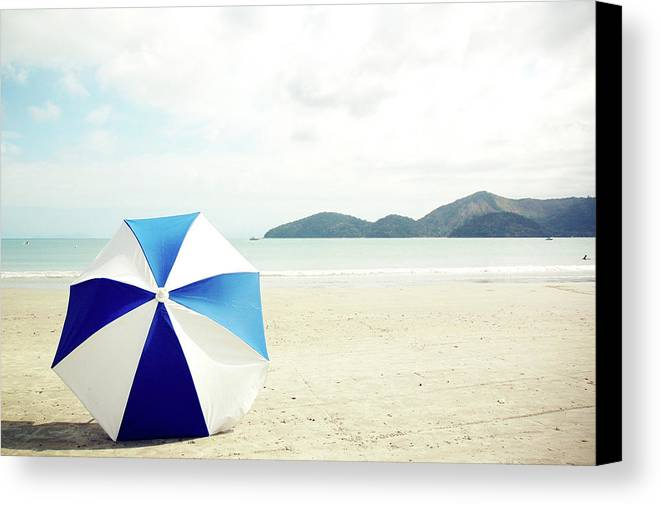 Horizontal Canvas Print featuring the photograph Umbrella On Sand by Grace Oda