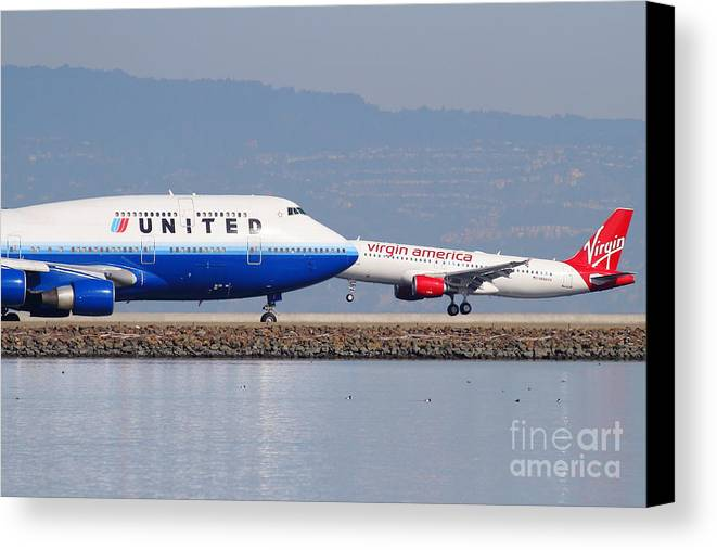 Virgin Canvas Print featuring the photograph United Airlines And Virgin America Airlines Jet Airplanes At San Francisco International Airport Sfo by Wingsdomain Art and Photography