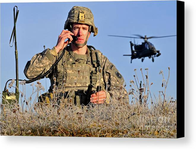 Grafenwoehr Canvas Print featuring the photograph U.s. Army Captain Directs An Ah-64 by Stocktrek Images