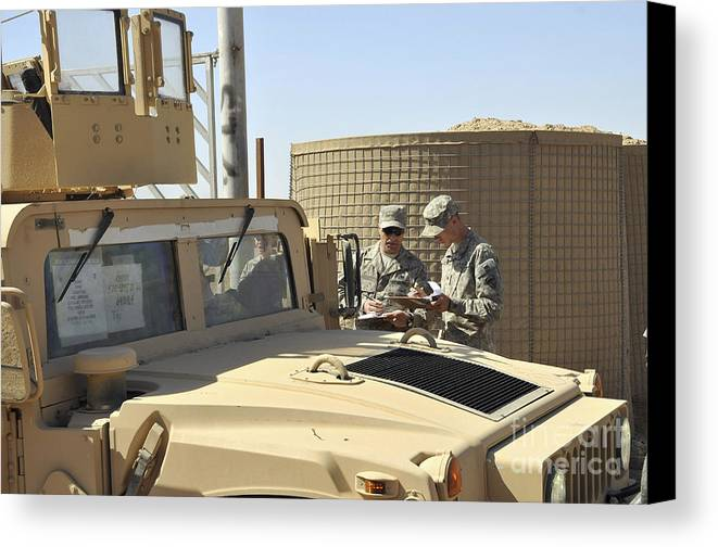 Helping Canvas Print featuring the photograph U.s. Army Soldiers Take Accountability by Stocktrek Images
