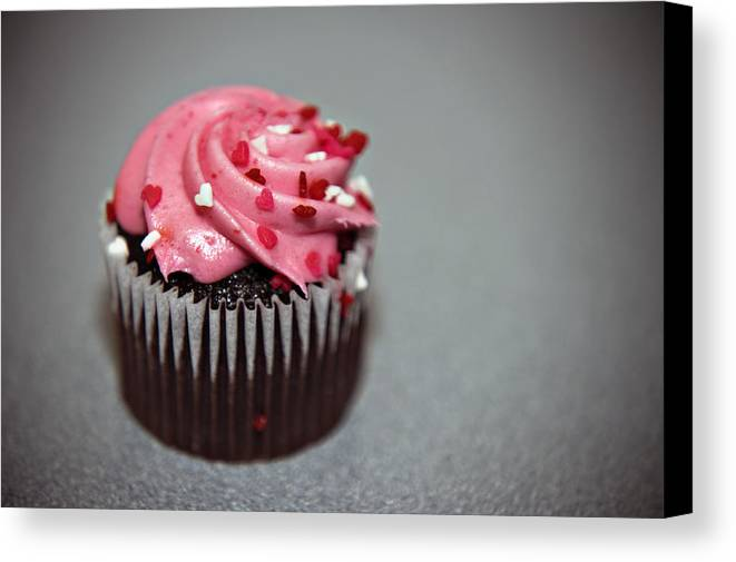 Against Canvas Print featuring the photograph Valentines Cupcake by Malania Hammer