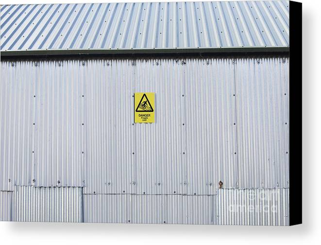 Architecture Canvas Print featuring the photograph Warning Sign On An Industrial Building by Iain Sarjeant