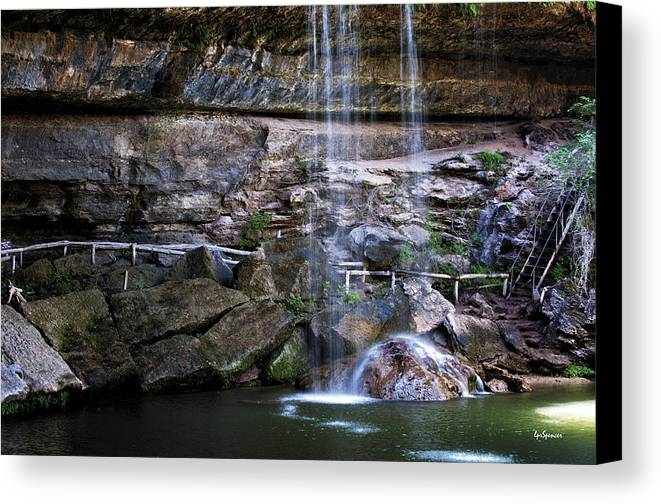 Water Canvas Print featuring the photograph Water Flow Over A Rock At Hamilton Pool by Lisa Spencer