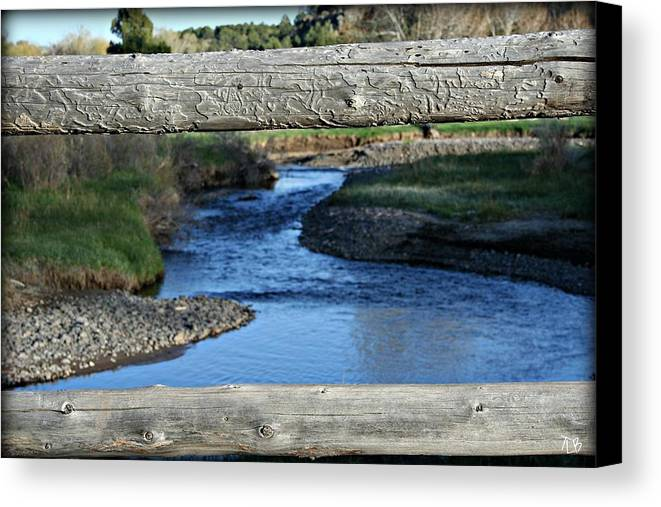 Water Canvas Print featuring the photograph Wooden Fence by Treena Bridges