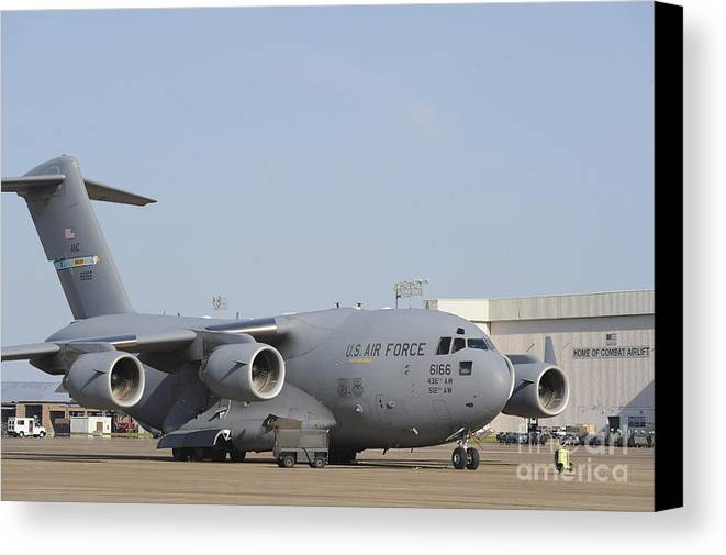 Military Canvas Print featuring the photograph A C-17 Globemaster IIi Parked by Stocktrek Images