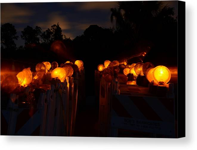 Barricade Canvas Print featuring the photograph Evening Lights by Lynda Dawson-Youngclaus
