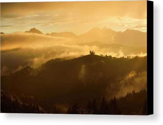 Golden Canvas Print featuring the photograph Golden Clouds And Fog At Sunrise In The Mountains Of Kamnik Savi by Reimar Gaertner