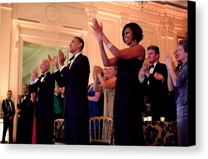 History Canvas Print featuring the photograph President And Michelle Obama Applaud by Everett