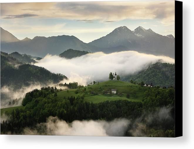 Sunrise Canvas Print featuring the photograph Rolling Fog At Sunrise In The Skofjelosko Hills With St Thomas C by Reimar Gaertner