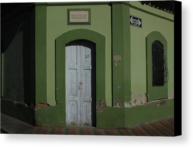 Door Canvas Print featuring the photograph White Door In A Green Wall by Robert Hamm