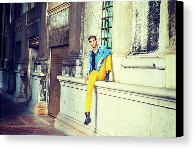 Young Canvas Print featuring the photograph Young Man Relaxing On Street by Alexander Image