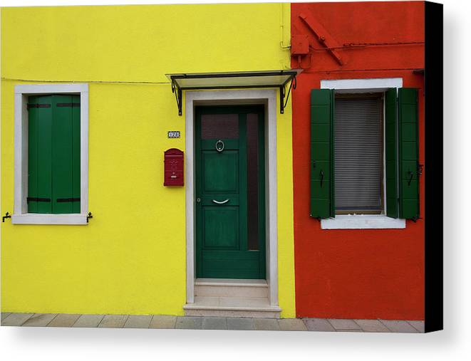 Architecture Canvas Print featuring the photograph Burano Anisland Of Multi Colored Homes On Canals North Of Venice Italy by Bruce Beck