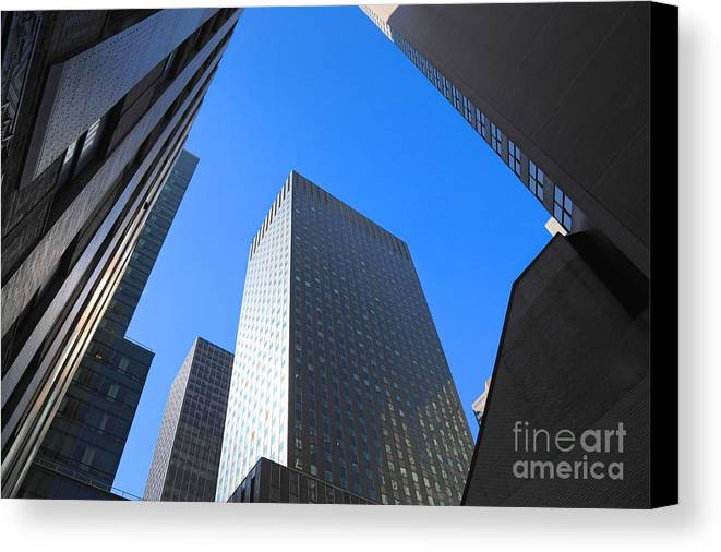 America Canvas Print featuring the photograph Dark Manhattan Skyscrapers by Jannis Werner