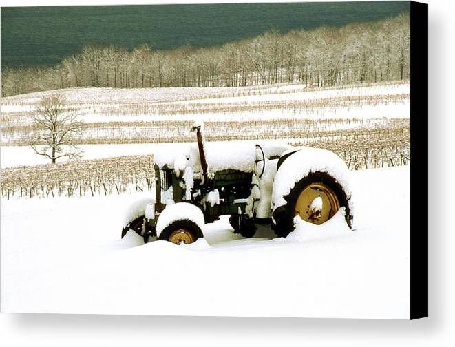 Canvas Print featuring the photograph Tractor In Snowy Vineyard by Roger Soule