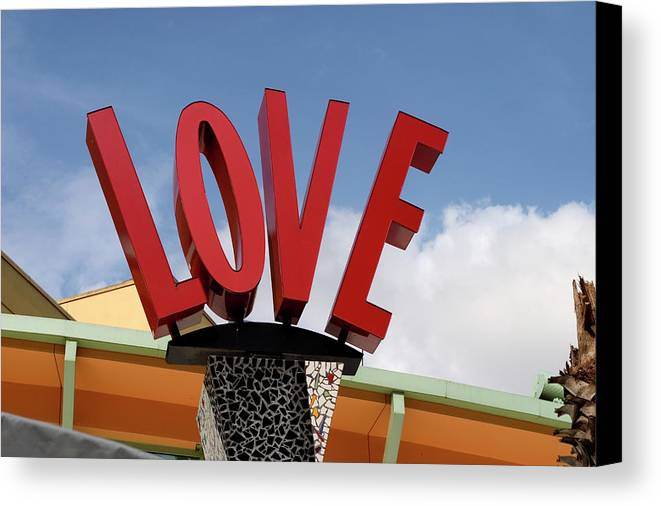 Sign Canvas Print featuring the photograph Love Disney by Carl Purcell