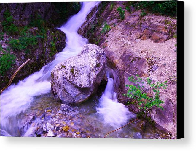 Rivers Canvas Print featuring the photograph A Boulder Splitting The Rocks by Jeff Swan