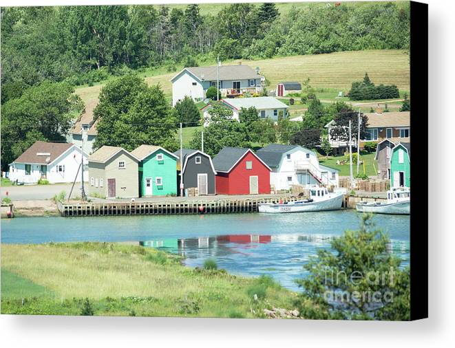 Homes Canvas Print featuring the photograph A Row Of Four by Judy Tomlinson