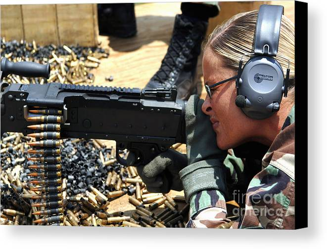 Color Image Canvas Print featuring the photograph A Soldier Fires An M240b Medium Machine by Stocktrek Images